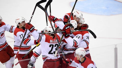 <p>               The Carolina Hurricanes celebrate after Game 7 of an NHL hockey first-round playoff series against the Washington Capitals, Wednesday, April 24, 2019, in Washington. The Hurricanes won 4-3 in double overtime. (AP Photo/Nick Wass)             </p>