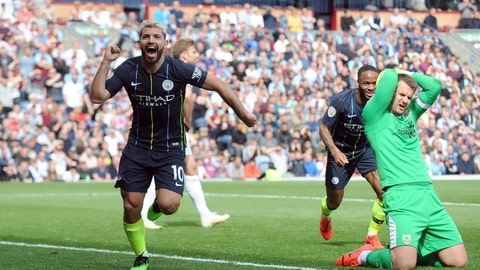 <p>               Manchester City's Sergio Aguero, left, celebrates after scoring his side's opening goal during the English Premier League soccer match between Burnley and Manchester City at Turf Moor in Burnley, England, Sunday, April 28, 2019. (AP Photo/Rui Vieira)             </p>