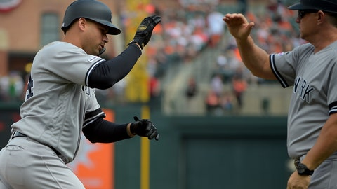 <p>               New York Yankees designated hitter Gary Sanchez (24) celebrates with New York Yankees third base coach Phil Nevin (88) after hitting a home run in the third inning of a baseball game against the Baltimore Orioles, Sunday, April 7, 2019, in Baltimore. (AP Photo/Will Newton)             </p>