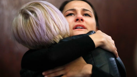 <p>               Bailey Kowalski hugs a friend after a news conference in East Lansing, Mich., Thursday, April 11, 2019. The 22-year-old Michigan State University student is speaking publicly a year after suing the school, alleging that three former men's basketball players raped her in 2015 and that she was discouraged by counseling center staff from reporting what happened. (AP Photo/Paul Sancya)             </p>