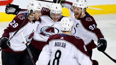 <p>               Colorado Avalanche left wing Gabriel Landeskog (92) celebrates his goal against the Calgary Flames with teammates Nathan MacKinnon (29), Tyson Barrie (4) and Cale Makar (8) during the first period of Game 5 of an NHL hockey first-round playoff series Friday, April 19, 2019, in Calgary, Alberta. (Larry MacDougal/The Canadian Press via AP)             </p>