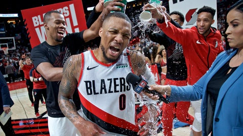 <p>               Portland Trail Blazers' Damian Lillard (0) gets water poured on him by teammates Rodney Hood, left, and guard Evan Turner, right, after Game 5 of an NBA basketball first-round playoff series against the Oklahoma City Thunder, Tuesday, April 23, 2019, in Portland, Ore. The Trail Blazers won 118-115. (AP Photo/Craig Mitchelldyer)             </p>