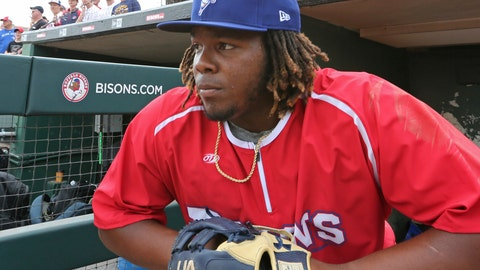 <p>               FILE - In this July 31, 2018, file photo, Buffalo Bisons third baseman Vladimir Guerrero Jr. looks on before a minor league baseball against the Lehigh Valley IronPigs in Buffalo, N.Y. The Toronto Blue Jays top prospect says he feels ready to finally make the jump to the majors, while adding the decision is out of his control. Blue Jays assistant general manager Joe Sheehan said this week the team is still evaluating when to make the move. (AP Photo/Jeffrey T. Barnes, File)             </p>