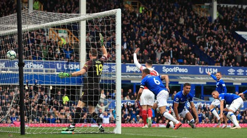 <p>               Everton's Phil Jagielka, center, scores his side's first goal of the game as Arsenal players appeal during their English Premier League soccer match at Goodison Park, Liverpool, England, Sunday, April 7, 2019. (Peter Byrne/PA via AP)             </p>