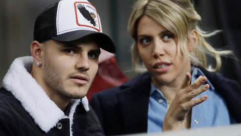 """<p>               FILE - In this Thursday, Feb. 21, 2019, Inter Milan's Mauro Icardi is flanked by his wife Wanda Nara as they sit in the stands during the Europa League, round of 32, second leg soccer match between Inter Milan and SK Rapid Vienna, at the San Siro stadium in Milan, Italy. Mauro Icardi has been left off Inter Milan's squad for Sunday's match against Lazio following a six-week exile from the club. Icardi resumed training with Inter over the international break, having seemingly cleared up his differences with the club after being stripped of the captaincy amid protracted contract negotiations. So it was a surprise when Inter coach Luciano Spalletti announced Saturday that he now sees Icardi """"like a new player as he was out for so long. I still hold that he can't be ready yet to help his teammates so he won't be in the squad tomorrow."""" (AP Photo/Luca Bruno, File)             </p>"""