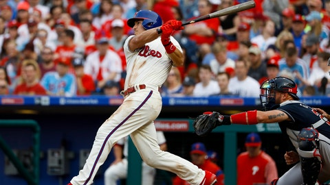 <p>               Philadelphia Phillies' J.T. Realmuto, left, follows through after hitting a two-run home run off Atlanta Braves relief pitcher Wes Parsons during the fifth inning of a baseball game, Saturday, March 30, 2019, in Philadelphia. Braves catcher Tyler Flowers, right, looks on. (AP Photo/Matt Slocum)             </p>