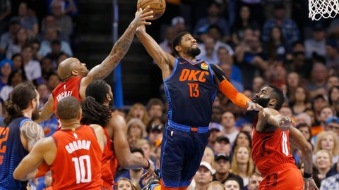 <p>               Houston Rockets forward P.J. Tucker, left, reaches up to block a shot by Oklahoma City Thunder forward Paul George (13) as George shoots between Tucker and James Harden (13) during the first half of an NBA basketball game Tuesday, April 9, 2019, in Oklahoma City. (AP Photo/Sue Ogrocki)             </p>