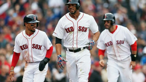 <p>               Boston Red Sox's Xander Bogaerts, center, celebrates his three-run home run that also drove in Mookie Betts, left, and J.D. Martinez, right, during the eighth inning of a baseball game against the Baltimore Orioles in Boston, Sunday, April 14, 2019. (AP Photo/Michael Dwyer)             </p>