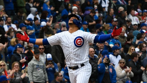 <p>               Chicago Cubs' Willson Contreras gestures after he hit a home run during the first inning of a baseball game against the Los Angeles Angels Friday, April 12, 2019, in Chicago. (AP Photo/Matt Marton)             </p>