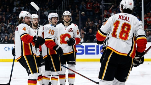 <p>               Calgary Flames forward Derek Ryan (10) celebrates his goal with teammates against the Los Angeles Kings during the third period of an NHL hockey game, Monday, April 1, 2019, in Los Angeles. Flames won 7-2. (AP Photo/Ringo H.W. Chiu)             </p>