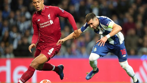 <p>               Liverpool's Virgil van Dijk, left, duels for the ball with Porto midfielder Hector Herrera during the Champions League quarterfinals, 2nd leg, soccer match between FC Porto and Liverpool at the Dragao stadium in Porto, Portugal, Wednesday, April 17, 2019. (AP Photo/Luis Vieira)             </p>