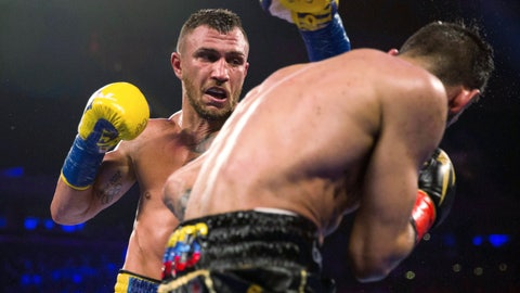 <p>               FILE - In this May 12, 2018, file photo, Vasiliy Lomachenko, left, of Ukraine, throws a punch at Jorge Linares, of Venezuela, during the WBA lightweight championship boxing match in New York. Lomachenko is a significant favorite when he defends his two lightweight titles on Friday, April 12, against Britain's Anthony Crolla at Staples Center in Los Angeles. (AP Photo/Kevin Hagen, File)             </p>