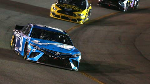 RICHMOND, VA - APRIL 13:  Martin Truex Jr, driver of the #19 Auto Owners Insurance Toyota, leads a pack of cars during the Monster Energy NASCAR Cup Series Toyota Owners 400 at Richmond Raceway on April 13, 2019 in Richmond, Virginia.  (Photo by Sean Gardner/Getty Images)
