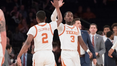 <p>               Texas guard Matt Coleman III (2) and guard Courtney Ramey (3) celebrate during the first half of a final college basketball game in the National Invitational Tournament against the Lipscomb, Thursday, April 4, 2019, at Madison Square Garden in New York. (AP Photo/Mary Altaffer)             </p>