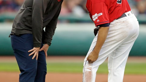<p>               A trainer looks at Cleveland Indians starting pitcher Carlos Carrasco, right, as he puts pressure on his knee after an injury at first base in the fourth inning of a baseball game against the Miami Marlins, Tuesday, April 23, 2019, in Cleveland. Carrasco pitched four innings and gave up two runs. (AP Photo/Tony Dejak)             </p>