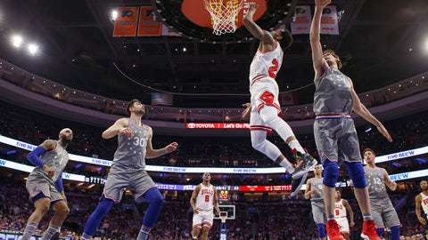 <p>               Chicago Bulls' Walt Lemon Jr., center right, puts up the shot after getting past Philadelphia 76ers' Boban Marjanovic, right, of Serbia, during the first half of an NBA basketball game, Wednesday, April 10, 2019, in Philadelphia. (AP Photo/Chris Szagola)             </p>
