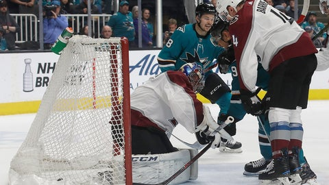 <p>               San Jose Sharks left wing Evander Kane, second from right, scores a goal between Colorado Avalanche goaltender Semyon Varlamov, left, and defenseman Tyson Barrie (4) during the first period of an NHL hockey game in San Jose, Calif., Saturday, April 6, 2019. (AP Photo/Jeff Chiu)             </p>