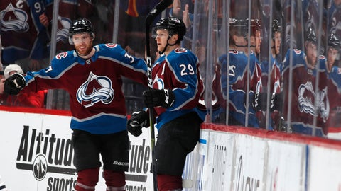 <p>               Colorado Avalanche left wing J.T. Compher, left, congratulates center Nathan MacKinnon after he scored a goal against the Edmonton Oilers in the second period of an NHL hockey game Tuesday, April 2, 2019, in Denver. (AP Photo/David Zalubowski)             </p>