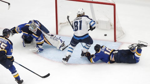 <p>               Winnipeg Jets left wing Kyle Connor (81) scores the winning goal between St. Louis Blues goaltender Jordan Binnington (50) and Blues' Brayden Schenn (10) during overtime in Game 4 of an NHL first-round hockey playoff series Tuesday, April 16, 2019, in St. Louis. The Jets won 2-1 to even the series 2-2. (AP Photo/Jeff Roberson)             </p>