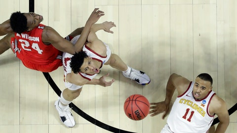 <p>               Iowa State's Talen Horton-Tucker (11) and Lindell Wigginton watch a rebound alongside Ohio State's Andre Wesson (24) during the first half of a first round men's college basketball game in the NCAA Tournament Friday, March 22, 2019, in Tulsa, Okla. (AP Photo/Jeff Roberson)             </p>