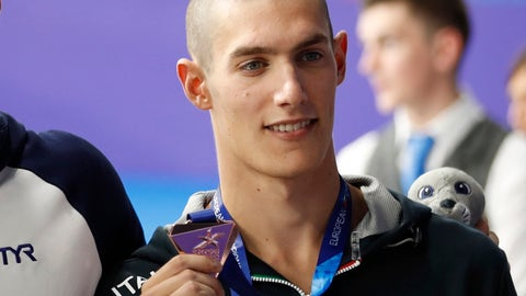 <p>               FILE - In this file photo dated Thursday, Aug. 9, 2018 bronze medalist Andrea Vergani of Italy poses on the podium of the 50 meters freestyle men final at the European Swimming Championships in Glasgow, Scotland. The Italian swimmer who posted the world's best time in the men's 50-meter freestyle this year has been provisionally suspended after testing positive for cannabis. (AP Photo/Darko Bandic, FILE)             </p>