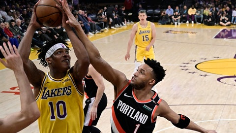 <p>               Los Angeles Lakers forward Jemerrio Jones, left, shoots as Portland Trail Blazers guard Evan Turner defends during the first half of an NBA basketball game Tuesday, April 9, 2019, in Los Angeles. (AP Photo/Mark J. Terrill)             </p>