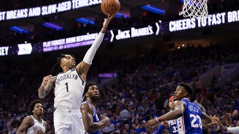 <p>               Brooklyn Nets' D'Angelo Russell, left, goes up for the shot as he gets past Philadelphia 76ers' Joel Embiid, center, of Cameroon, during the second half in Game 1 of a first-round NBA basketball playoff series, Saturday, April 13, 2019, in Philadelphia. The Nets won 111-102. (AP Photo/Chris Szagola)             </p>