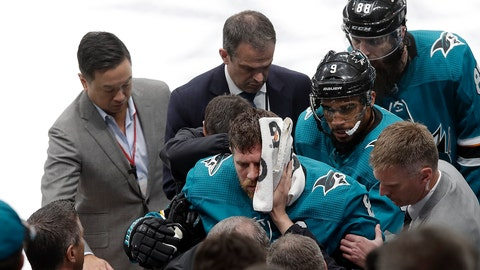 <p>               San Jose Sharks center Joe Pavelski, bottom center, is helped off the ice during the third period of Game 7 of an NHL hockey first-round playoff series against the Vegas Golden Knights in San Jose, Calif., Tuesday, April 23, 2019. (AP Photo/Jeff Chiu)             </p>