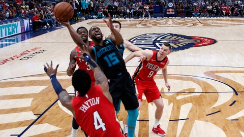 <p>               Charlotte Hornets guard Kemba Walker (15) drives to the basket between New Orleans Pelicans guard Elfrid Payton (4), center Julius Randle and guard Dairis Bertans (9) in the second half of an NBA basketball game in New Orleans, Wednesday, April 3, 2019. The Hornets won 115-109. (AP Photo/Gerald Herbert)             </p>