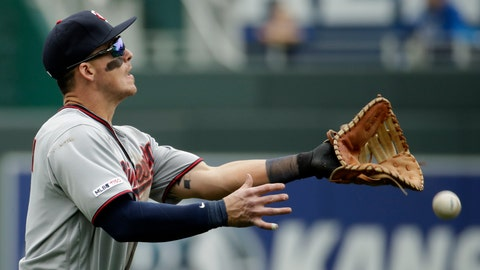 <p>               Minnesota Twins first baseman Tyler Austin can't make the catch on a single by Kansas City Royals' Martin Maldonado during the eighth inning of a baseball game Wednesday, April 3, 2019, in Kansas City, Mo. (AP Photo/Charlie Riedel)             </p>