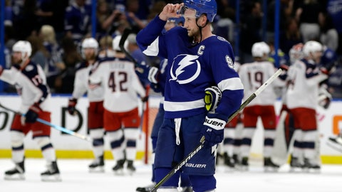 <p>               Tampa Bay Lightning center Steven Stamkos (91) skates off as the Columbus Blue Jackets celebrate their 4-3 win during Game 1 of an NHL Eastern Conference first-round hockey playoff series Wednesday, April 10, 2019, in Tampa, Fla. (AP Photo/Chris O'Meara)             </p>
