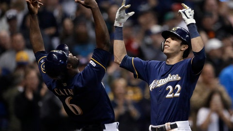 <p>               Milwaukee Brewers' Christian Yelich (22) celebrates with Lorenzo Cain (6) after hitting a three-run home run during the fifth inning of the team's baseball game against the St. Louis Cardinals on Tuesday, April 16, 2019, in Milwaukee. (AP Photo/Aaron Gash)             </p>