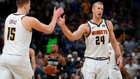 <p>               Denver Nuggets center Nikola Jokic, left, congratulates forward Mason Plumlee after Plumlee scored a basket against the Portland Trail Blazers in the second half of Game 1 of an NBA basketball second-round playoff series, Monday, April 29, 2019, in Denver. The Nuggets won 121-113. (AP Photo/David Zalubowski)             </p>