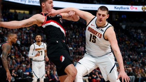 <p>               Denver Nuggets center Nikola Jokic, right, pushes off Portland Trail Blazers forward Meyers Leonard in the first half of Game 1 of an NBA basketball second-round playoff series Monday, April 29, 2019, in Denver. (AP Photo/David Zalubowski)             </p>