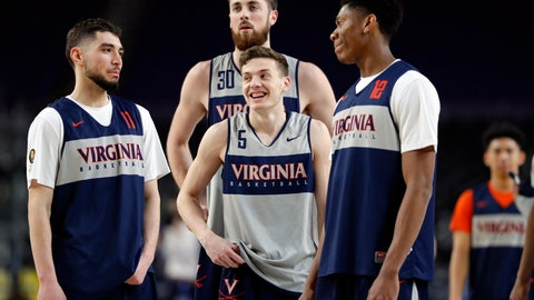 <p>               Virginia's Kyle Guy (5) laughs as he gather with Ty Jerome (11), Jay Huff (30) and De'Andre Hunter (12) during a practice session for the semifinals of the Final Four NCAA college basketball tournament, Friday, April 5, 2019, in Minneapolis. (AP Photo/Charlie Neibergall)             </p>