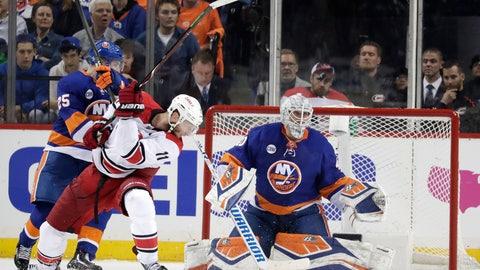 <p>               New York Islanders goaltender Robin Lehner, of Sweden, eyes the puck as teammate defenseman Devon Toews (25) blocks Carolina Hurricanes center Jordan Staal (11) during the second period of Game 1 of an NHL hockey second-round playoff series, Friday, April 26, 2019, in New York. (AP Photo/Julio Cortez)             </p>
