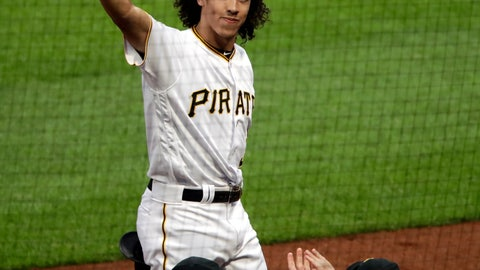 <p>               Pittsburgh Pirates' Cole Tucker takes a curtain call after hitting a two-run home run off San Francisco Giants starting pitcher Derek Holland for his first hit in his first Major League Baseball game in Pittsburgh, Saturday, April 20, 2019. (AP Photo/Gene J. Puskar)             </p>