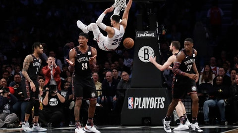 <p>               Brooklyn Nets' Rondae Hollis-Jefferson (24), Caris LeVert (22) and D'Angelo Russell (1) react to a dunk by Philadelphia 76ers' Ben Simmons (25) during the second half in Game 3 of a first-round NBA basketball playoff series Thursday, April 18, 2019, in New York. The 76ers won 131-115. (AP Photo/Frank Franklin II)             </p>