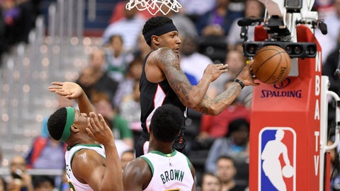 <p>               Washington Wizards guard Bradley Beal, top, passes the ball as Boston Celtics' Guerschon Yabusele, bottom left, and Jaylen Brown (7) defend during the first half of an NBA basketball game Tuesday, April 9, 2019, in Washington. (AP Photo/Nick Wass)             </p>