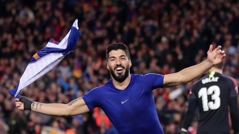 <p>               Barcelona forward Luis Suarez waves with his shirt as he celebrates scoring his side's first goal after passing Atletico goalkeeper Jan Oblak, right, during a Spanish La Liga soccer match between FC Barcelona and Atletico Madrid at the Camp Nou stadium in Barcelona, Spain, Saturday April 6, 2019. (AP Photo/Manu Fernandez)             </p>