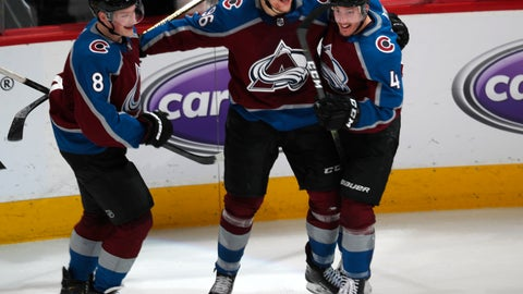 <p>               Colorado Avalanche right wing Mikko Rantanen, center, celebrates his overtime goal with defensemen Cale Makar, left, and Tyson Barrie in Game 4 of an NHL hockey playoff series against the Calgary Flames on Wednesday, April 17, 2019, in Denver. The Avalanche won 3-2. (AP Photo/David Zalubowski)             </p>