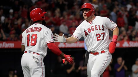 <p>               Los Angeles Angels' Mike Trout, right, is greeted by Brian Goodwin after he scored on a single by Albert Pujols during the first inning of a baseball game against the Milwaukee Brewers, Tuesday, April 9, 2019, in Anaheim, Calif. (AP Photo/Jae C. Hong)             </p>