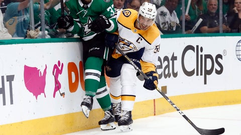 <p>               Dallas Stars' Justin Dowling (37) and Nashville Predators' Roman Josi (59) slam against the boards chasing after the puck in the first period of Game 6 in an NHL hockey first-round playoff series in Dallas, Monday, April 22, 2019. (AP Photo/Tony Gutierrez)             </p>