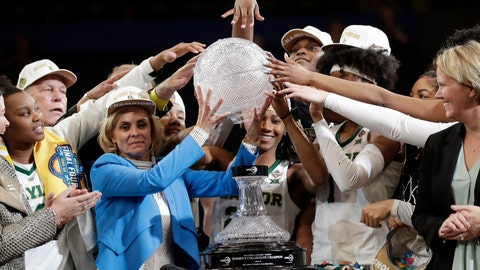 <p>               Baylor coach Kim Mulkey, in blue, and players raise part of the NCAA/WBCA coaches' trophy after Baylor defeated Notre Dame 82-81 in the Final Four championship game of the NCAA women's college basketball tournament, Sunday, April 7, 2019, in Tampa, Fla. (AP Photo/John Raoux)             </p>