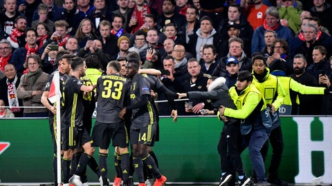 <p>               Juventus' Cristiano Ronaldo celebrates with his teammate after scoring his side's opening goal during the Champions League quarterfinal, first leg, soccer match between Ajax and Juventus at the Johan Cruyff ArenA in Amsterdam, Netherlands, Wednesday, April 10, 2019. (AP Photo/Martin Meissner)             </p>