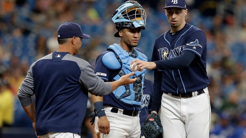 <p>               Tampa Bay Rays pitcher Blake Snell, right, hands the ball to manager Kevin Cash, left, as he is taken out of the game against the Kansas City Royals during the fourth inning of a baseball game Wednesday, April 24, 2019, in St. Petersburg, Fla. Looking on is Rays catcher Michael Perez. (AP Photo/Chris O'Meara)             </p>