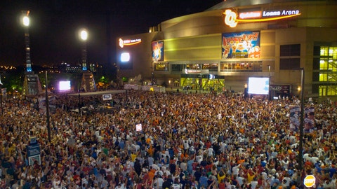 <p>               FILE - In this June 2, 2007, file photo, thousands of sports fans pack the plaza between Jacobs Field and Quicken Loans Arena in downtown Cleveland during Game 6 of the NBA basketball Eastern Conference playoff series in Cleveland. A person familiar with the decision says Cleveland's Quicken Loans Arena is being renamed Rocket Mortgage FieldHouse. The announcement of the change will be made Tuesday, April 9, 2019, at a news conference at the home of the NBA's Cavaliers, said the person who spoke Monday night to The Associated Press on condition of anonymity because the team is not revealing the nature of the media gathering. (AP Photo/Jeff Glidden, File)             </p>