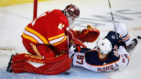 <p>               Edmonton Oilers' Connor McDavid, right, crashes into Calgary Flames goalie Mike Smith during the second period of an NHL hockey game Saturday, April 6, 2019, in Calgary, Alberta. McDavid left the game. (Jeff McIntosh/The Canadian Press via AP)             </p>