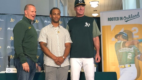<p>               Oakland Athletics designated hitter Khris Davis, center, poses with general manager David Forst, left, and manager Bob Melvin, right, during a news conference about his contract extension Friday, April 19 2019, in Oakland, Calif. (AP Photo/Janie McCauley)             </p>