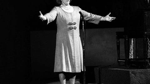 """<p>               FILE - In this May 13, 1975, file photo, Kate Smith sings """"God Bless America"""" before an NHL hockey Stanley Cup playoff game between the New York Islanders and the Philadelphia Flyers in Philadelphia. The New York Yankees have suspended the use of Smith's recording of """"God Bless America"""" during the seventh-inning stretch while they investigate an allegation of racism against the singer. (AP Photo, File)             </p>"""